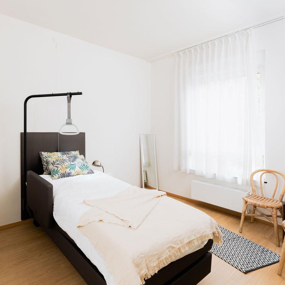 Chambre à coucher dans l'hôtel de soins à la Résidence Accordage